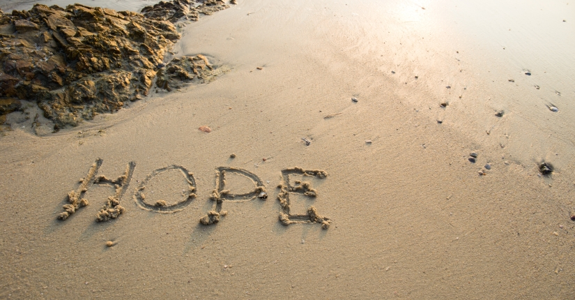 Hope written in the sand at the beach